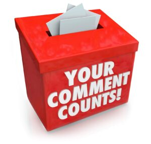 """Red box with slot on top for inserting paper with the words """"Your Comment Counts!"""""""